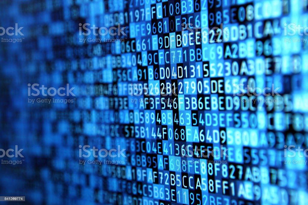 Hexadecimal programming data on computer monitor, blue background stock photo