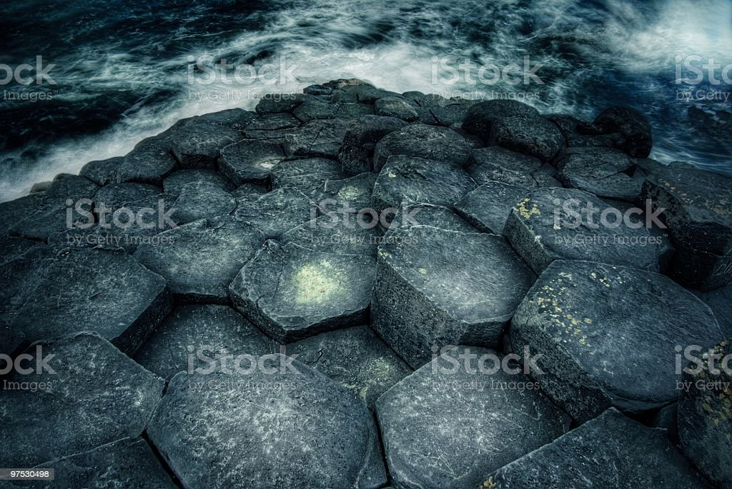 Hexagonal rock formation and sea at the Giants Causeway royalty-free stock photo