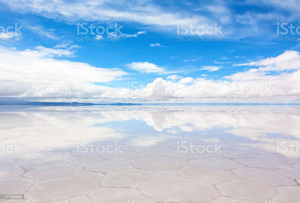 Hexagonal shape pattern on thin layer Lake Salar de Uyuni stock photo
