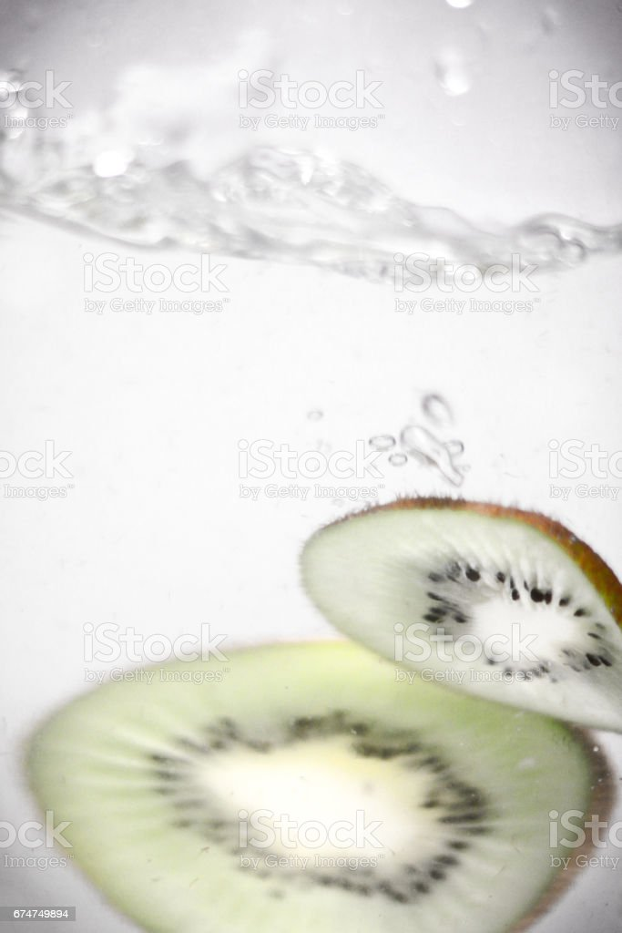 Hey fresh and cool kiwi jumping in cold water. stock photo