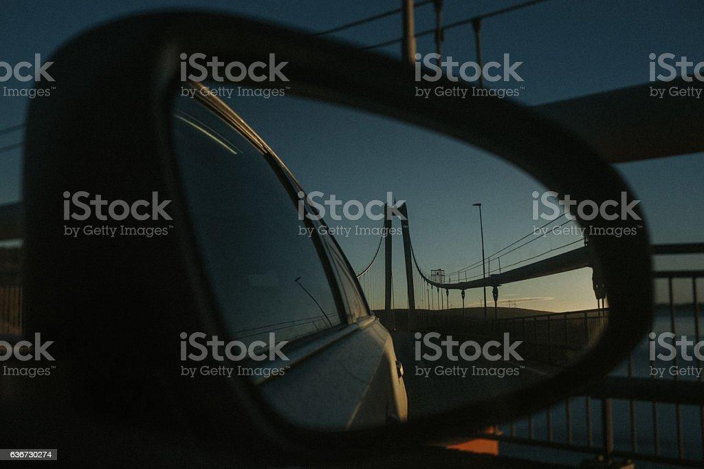 Höga Kusten bridge in car mirror at dusk stock photo