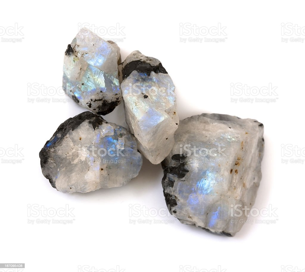 Hi quality raw moonstone rainbow gemstones on the white background. stock photo