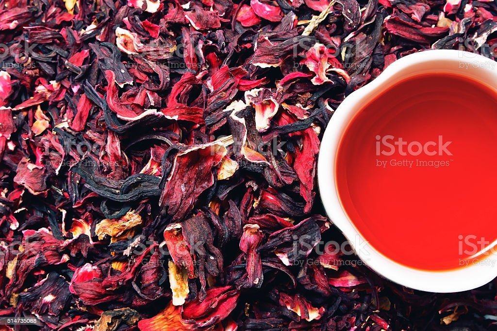 Hibiscus tea cup with tea leaves stock photo
