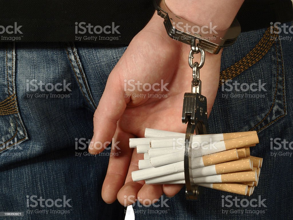 Hidden Cigarette Addiction stock photo