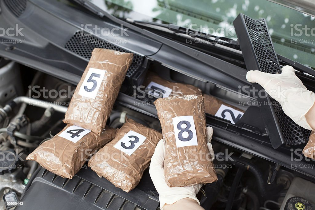 Hidden drugs in a vehicle compartment stock photo