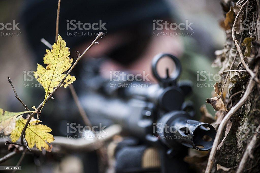 Hidden rifle close up stock photo