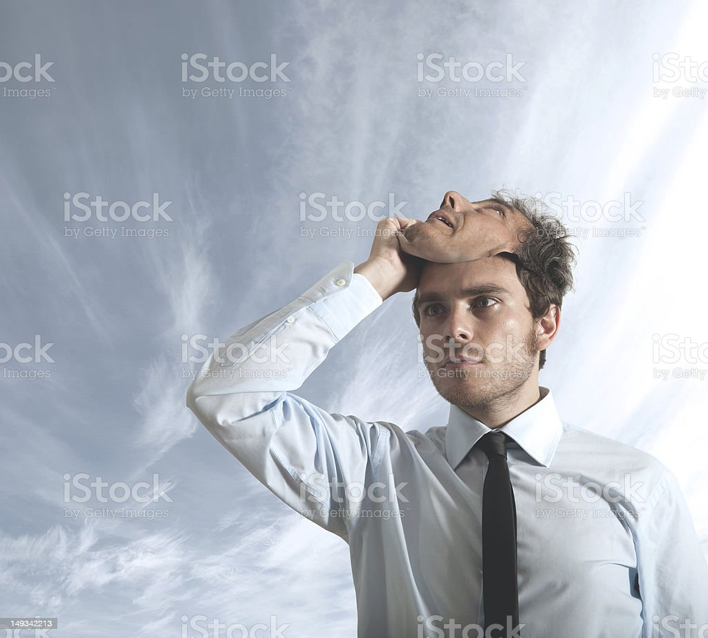 Hide behind a mask stock photo