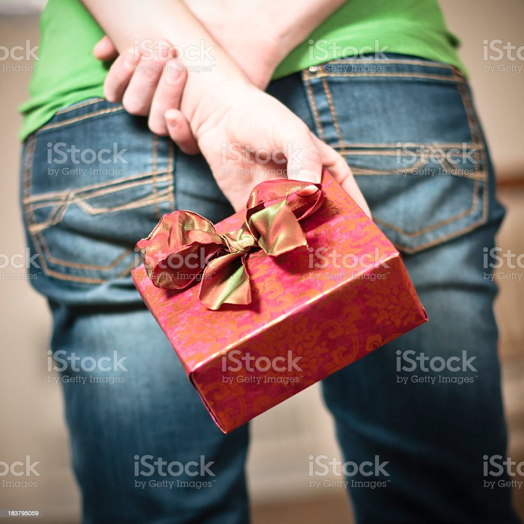 Hiding a gift royalty-free stock photo