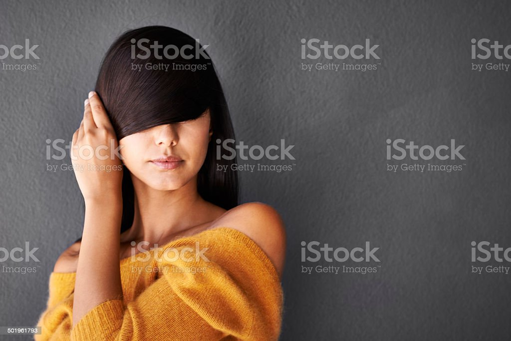 Hiding behind her sleek and sexy hair stock photo