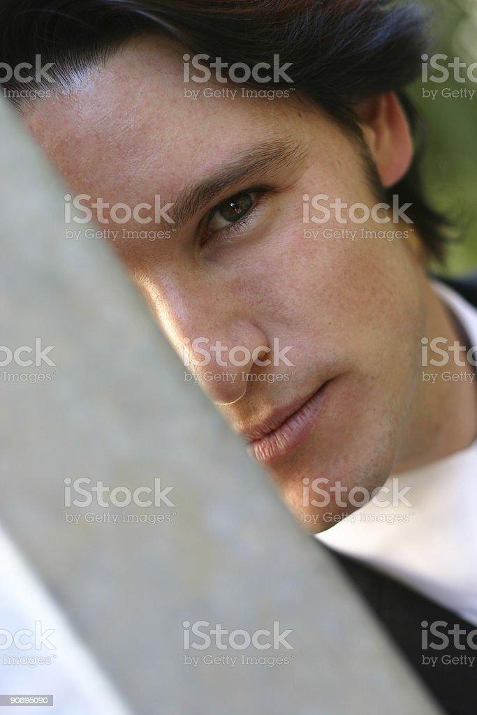 Hiding Businessman stock photo