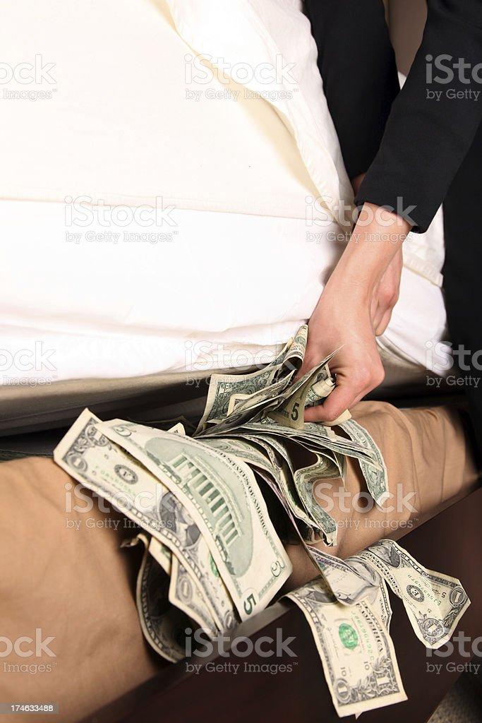 Hiding Money under a Mattress royalty-free stock photo