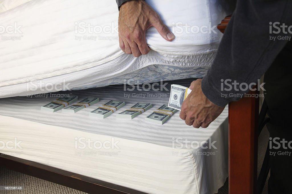 Hiding Money Under The Mattress stock photo
