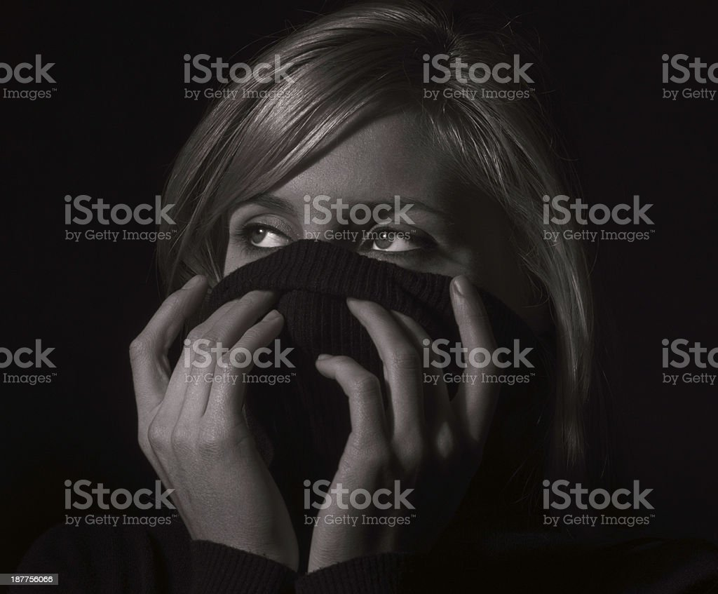 Hiding the face with her jumper royalty-free stock photo