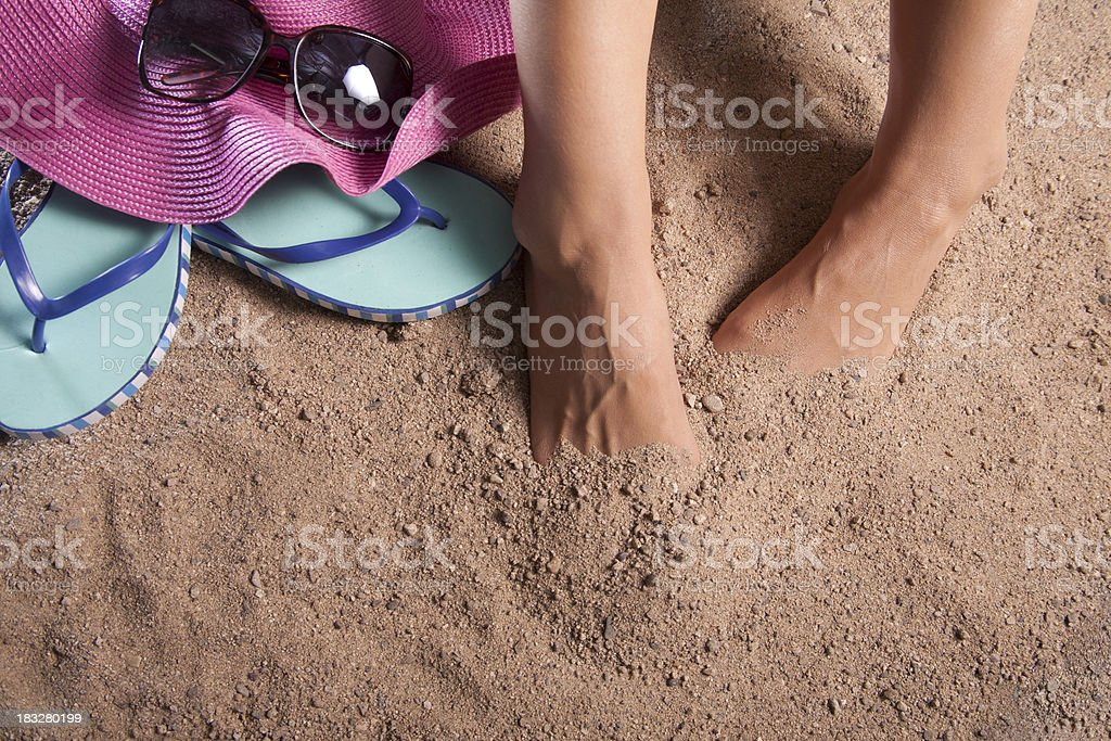 Hiding Toes in the Sand stock photo