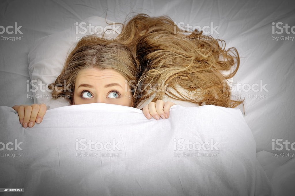 hiding woman stock photo