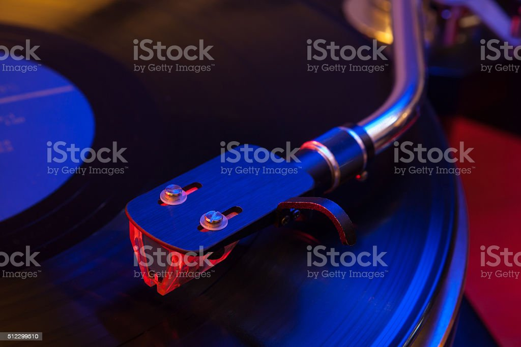 Hi-end turntable standing on red wood stand stock photo