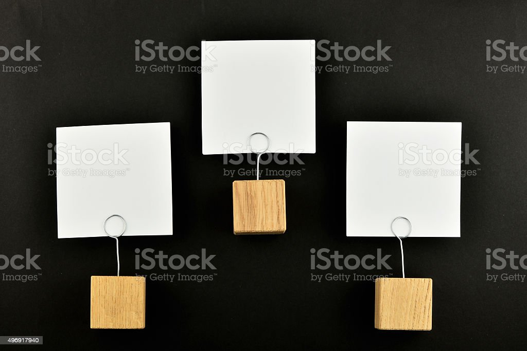 Hierarchy, Three paper notes with holders black background for p royalty-free stock photo