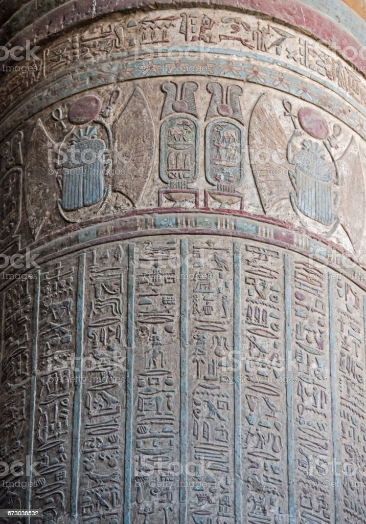 Hieroglyphic carvings on an ancient egyptian temple column stock photo