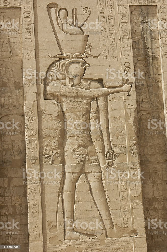 Hieroglyphic carvings on an Egyptian temple wall stock photo