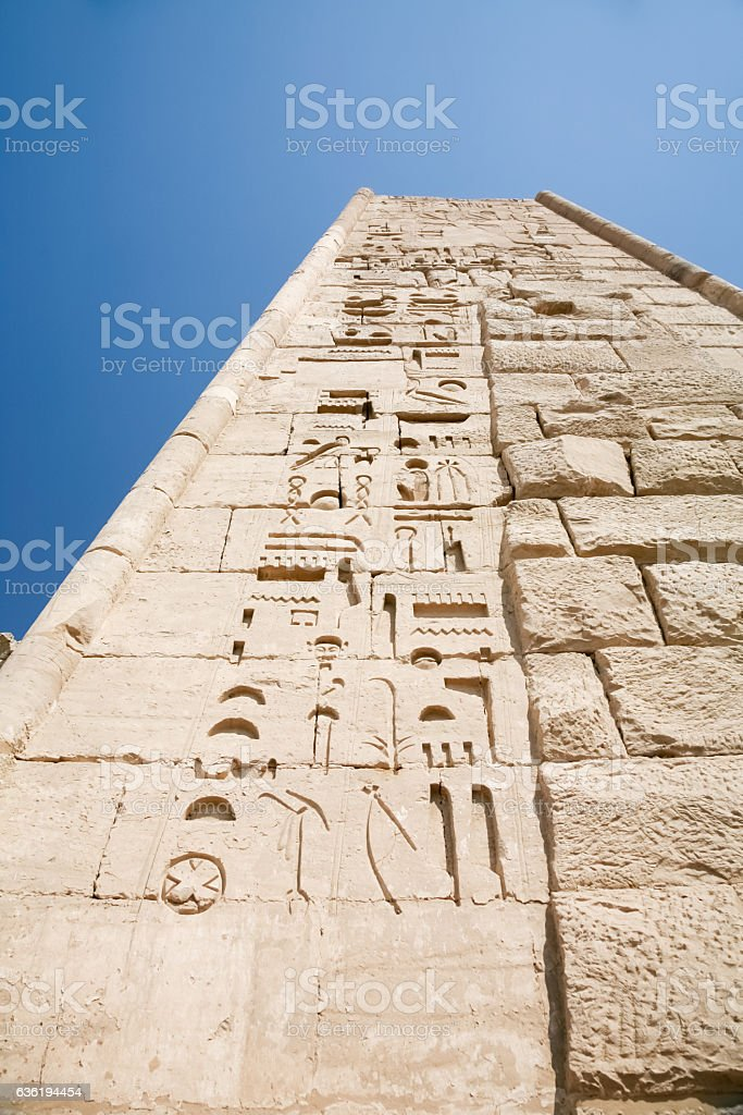 hieroglyphics in high wall temple stock photo