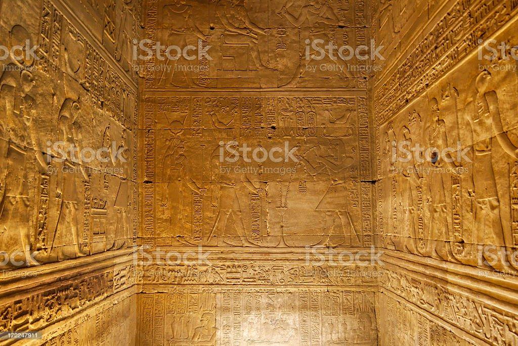Hieroglyphics on ancient chamber walls stock photo