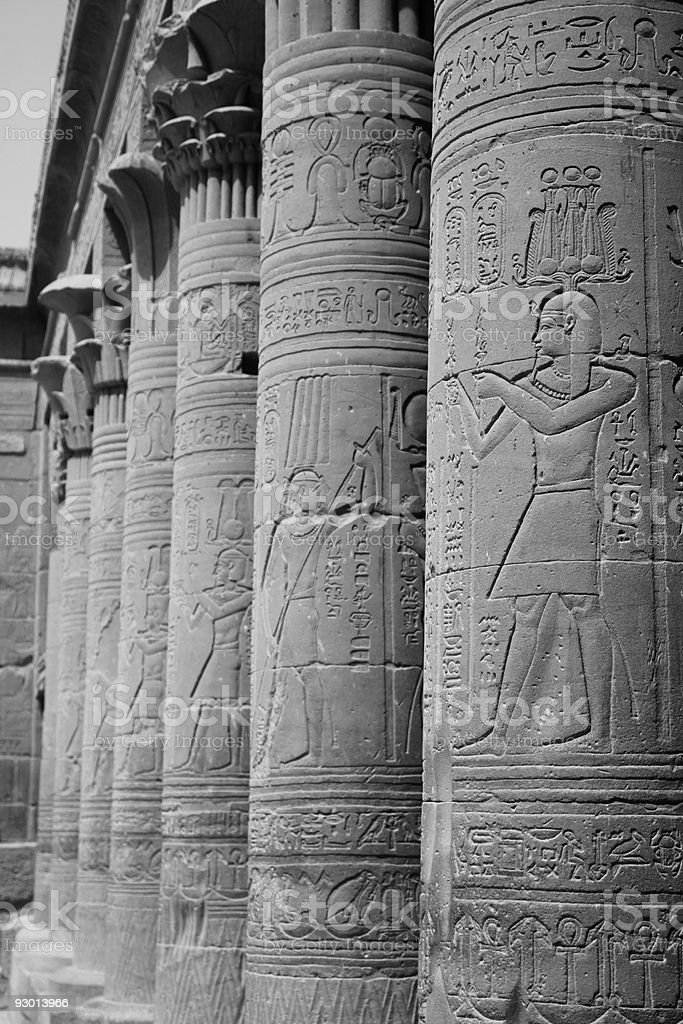 Hieroglyphics on columns in black and white stock photo