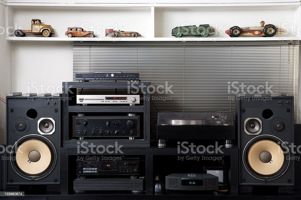 Hi-Fi sound system with vintage tin toy car stock photo