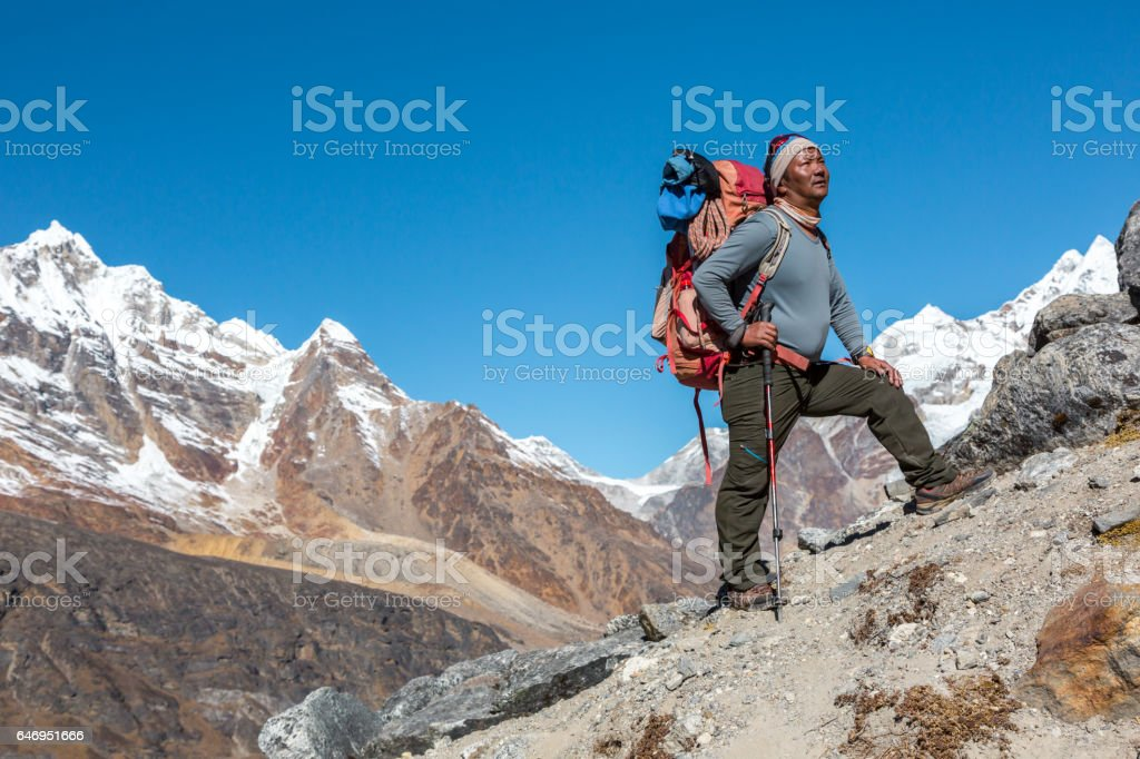High Altitude Himalaya Nepalese Guide looking Up stock photo