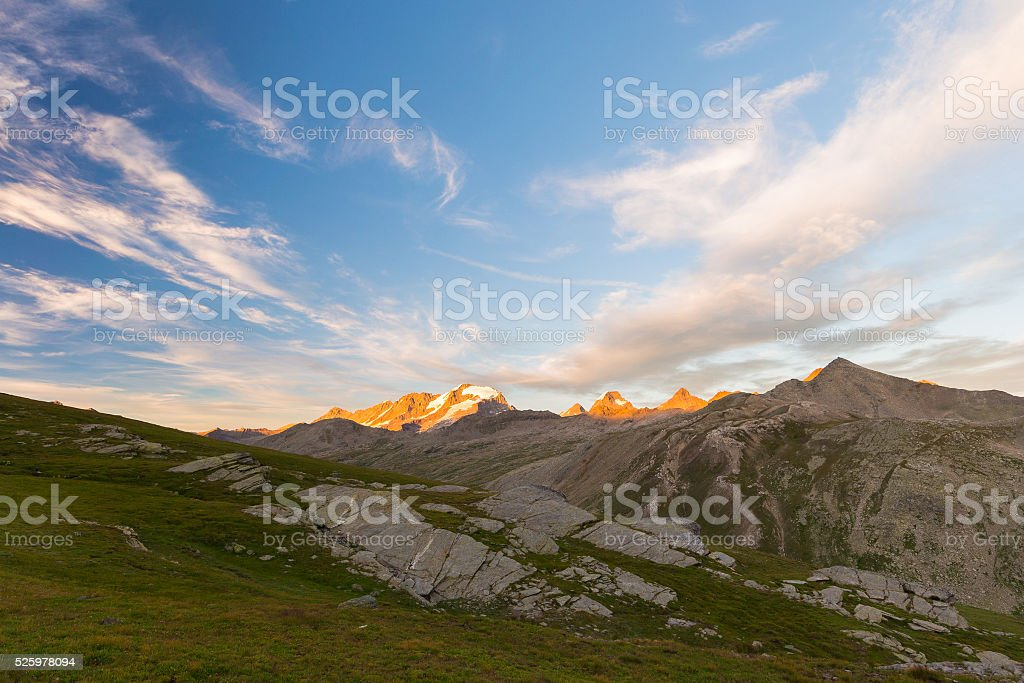 High altitude landscape, Gran Paradiso mountain range at sunset stock photo