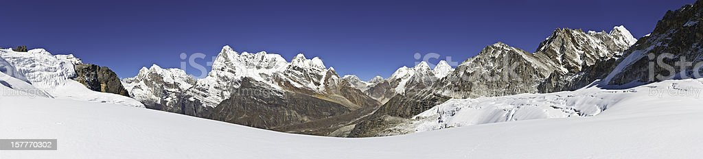 High altitude mountain wilderness white glaciers snow capped peaks panorama stock photo