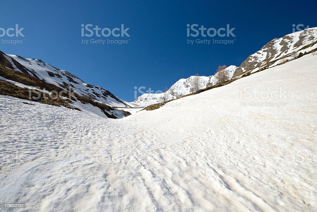 High altitude snow melting pattern royalty-free stock photo