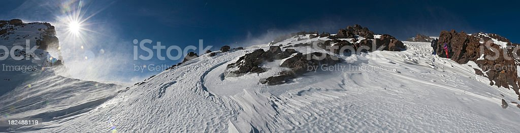 High altitude snow summit sunburst mountaineers ridge panorama Atlas Morocco stock photo