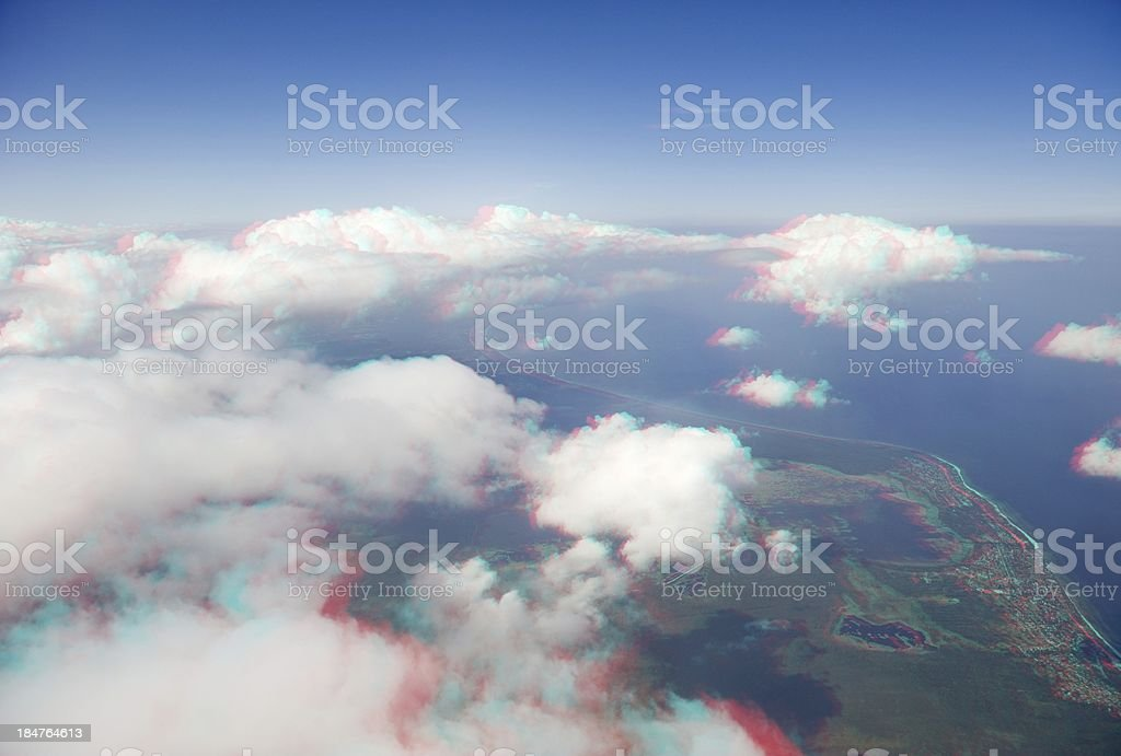 High altitude view of clouds and coastline in 3D. royalty-free stock photo