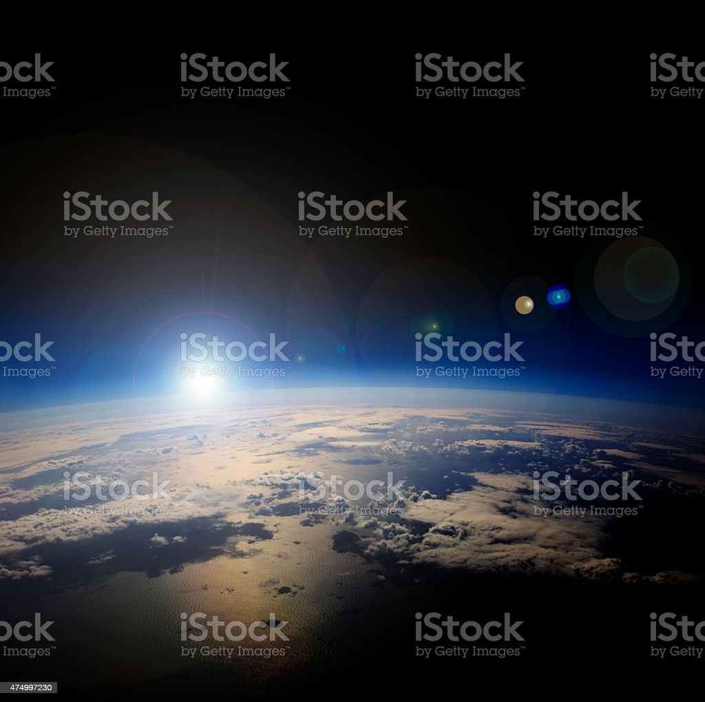 High altitude view of sunrise over Earth. stock photo
