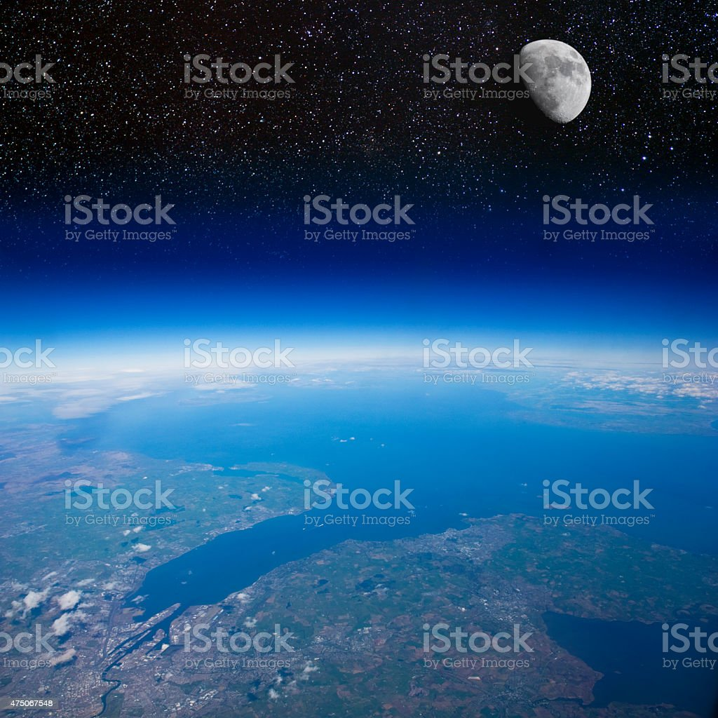 High altitude view of the Earth and the Moon. stock photo