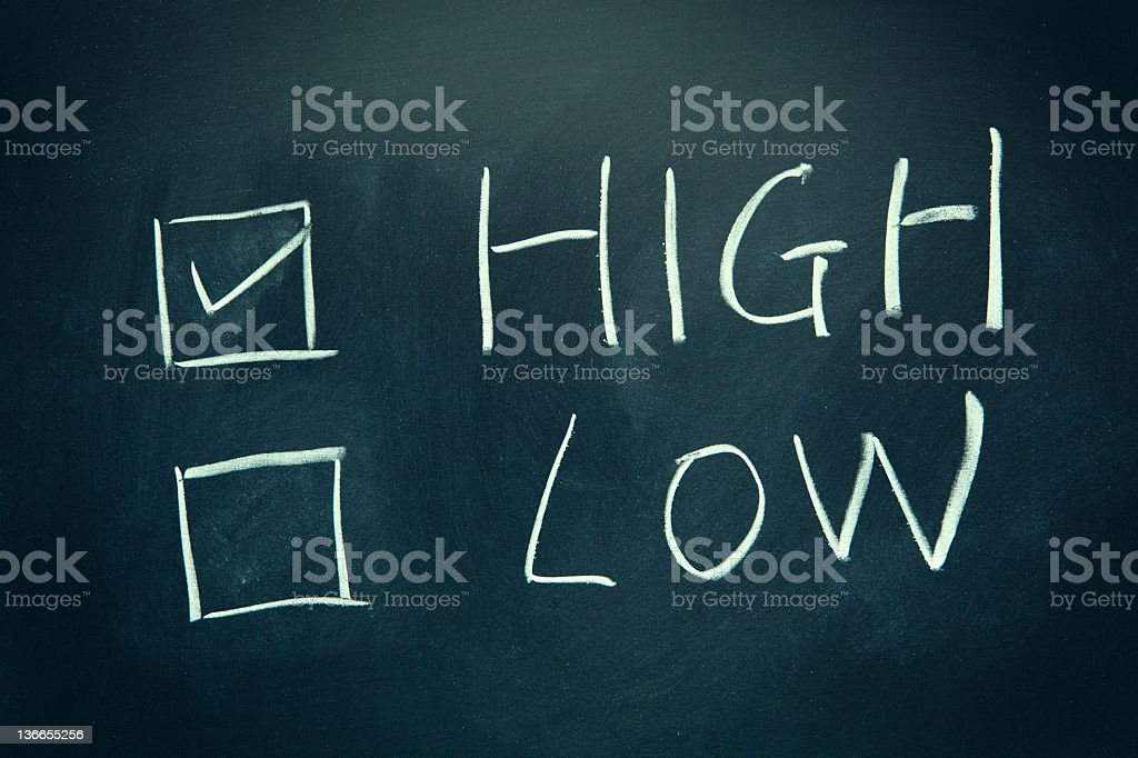 High and Low check boxes written on a blackboard. royalty-free stock photo