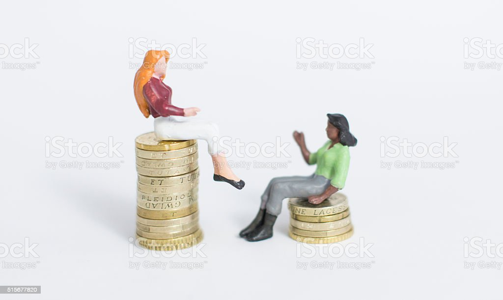 high and low pay inequality stock photo