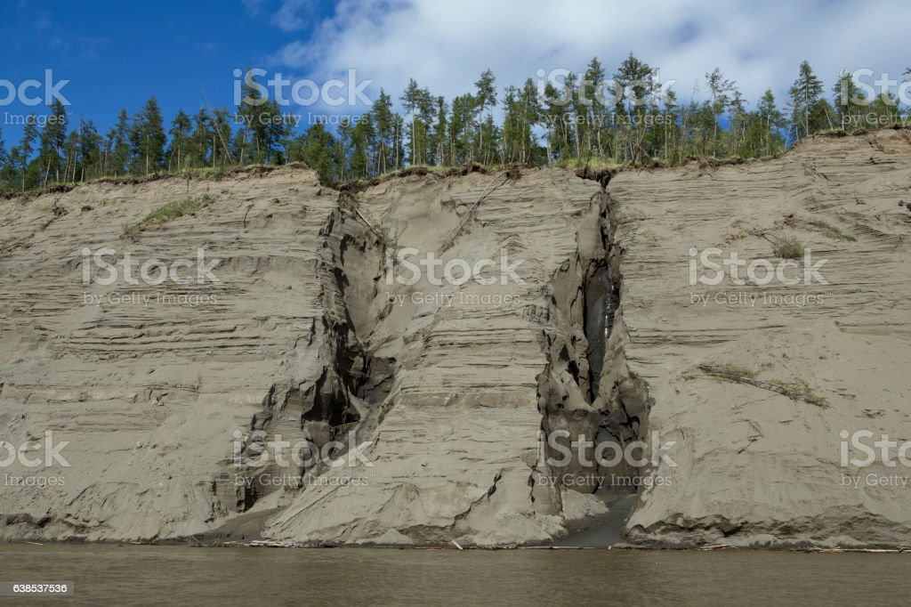 High and steep sandy river bank. stock photo