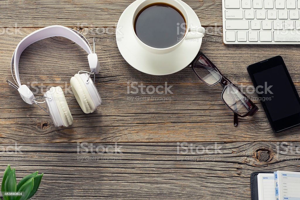 High angle shot of mobile devices and wireless headphones. stock photo