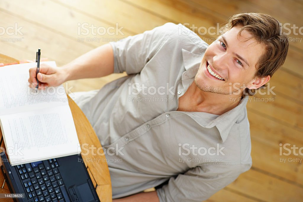 High angle view of a young man studying royalty-free stock photo