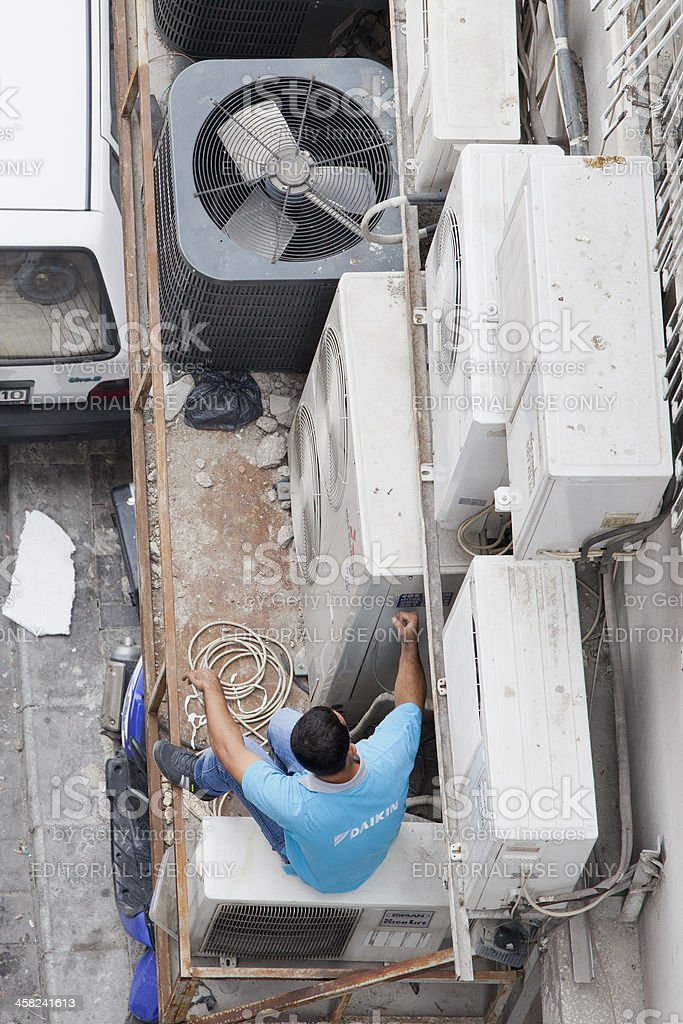 High Angle View of Air Conditioner Serving Man stock photo