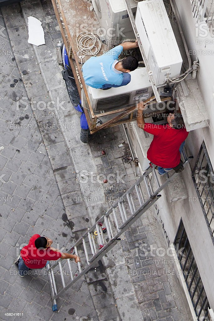 High Angle View of Air conditioner Serving Men stock photo