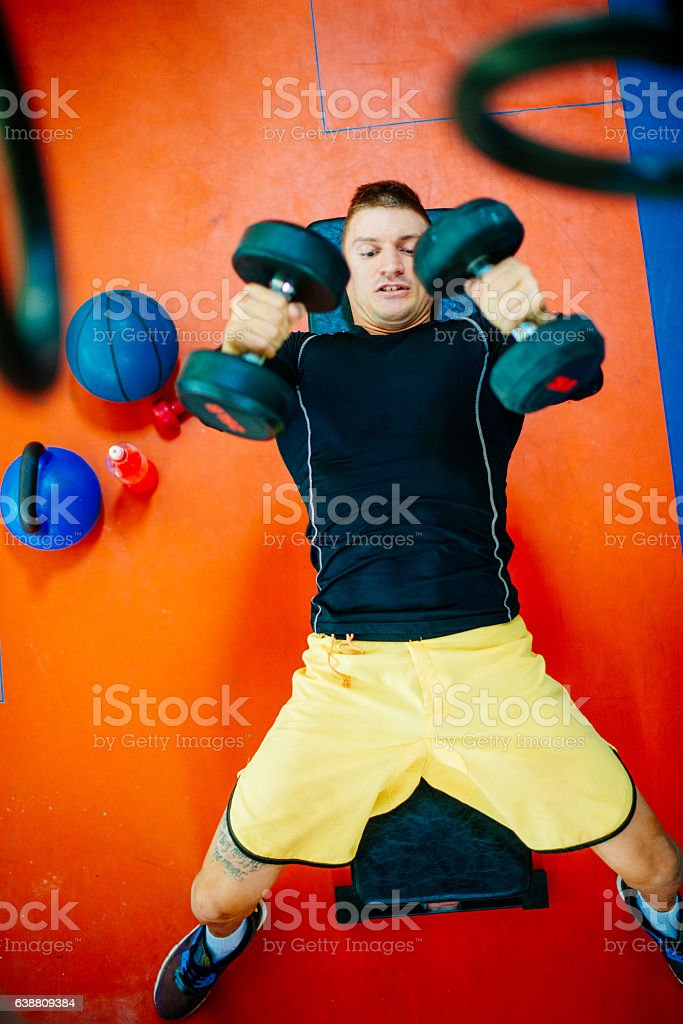 High angle view of athlete exercising pectoral muscles stock photo