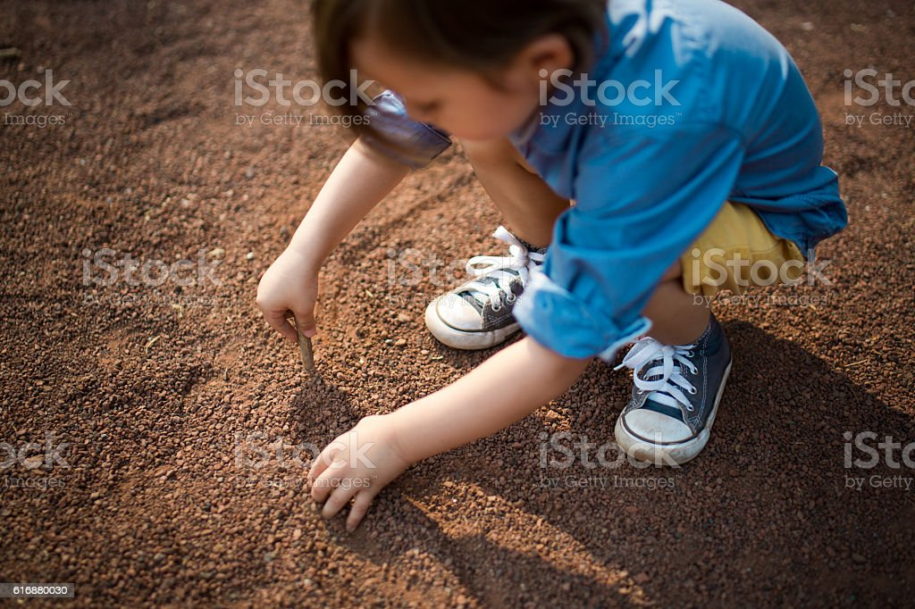 High angle view of boy playing with dirt stock photo