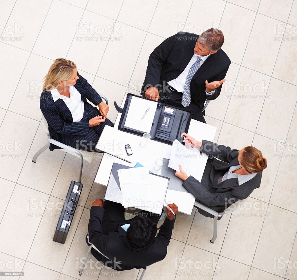 High angle view of business colleagues during meeting royalty-free stock photo