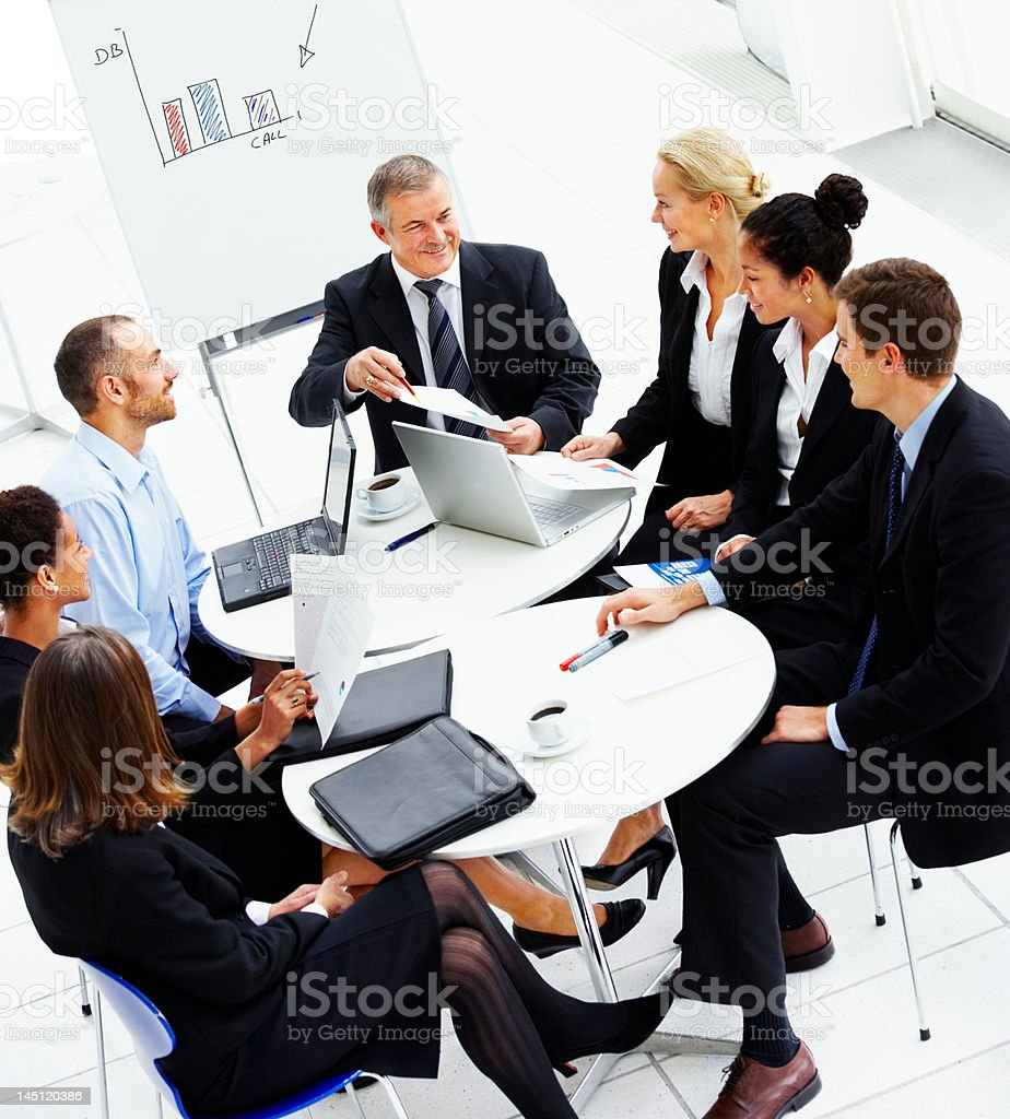 High angle view of business people discussing in a meeting stock photo