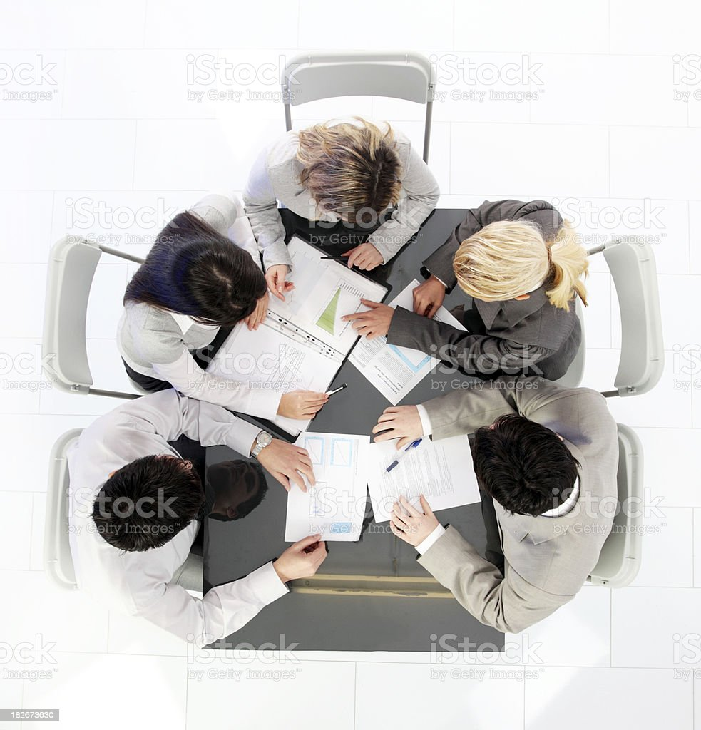 High angle view of business people working on the meeting. royalty-free stock photo