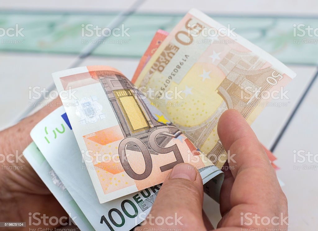 High angle view of businessman counting money stock photo