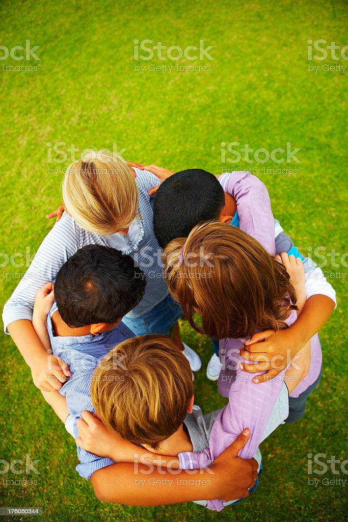 High angle view of children forming a huddle royalty-free stock photo