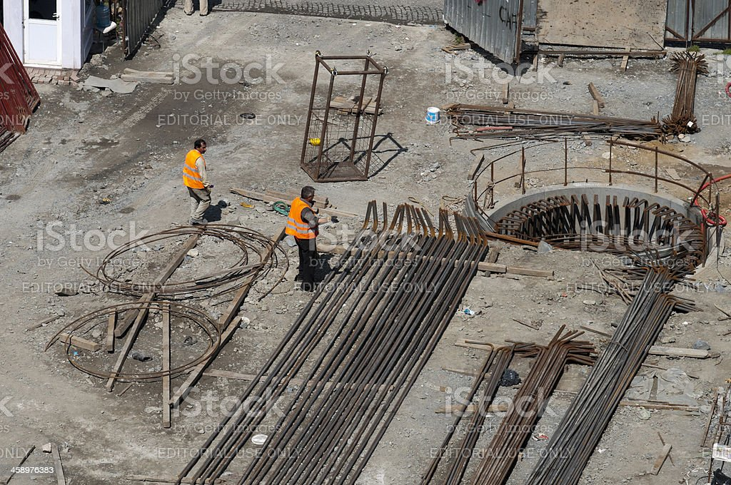 High angle view of construction workers working at site royalty-free stock photo